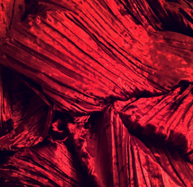 this is a photo of crushed red velvet fabric. nrfabrics deals in crushed velvet fabric wholesale