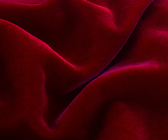velvet fabric picture- this is a photo of  plain velvet fabric in red colour.